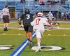 Baldwinsville Bees Jason Dobek (17) and Syracuse Cougars Jahaad Henry (3) go after the ball in Section III Boys Lacrosse Semi-Finals action at the Bragman Stadium in Cicero, New York on Thursday, May 26, 2016.  Baldwinsville won 16-5.