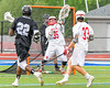 Baldwinsville Bees goalie Riley Smith (35) makes a save on Syracuse Cougars John Elliott (22) in Section III Boys Lacrosse Semi-Finals action at the Bragman Stadium in Cicero, New York on Thursday, May 26, 2016.  Baldwinsville won 16-5.
