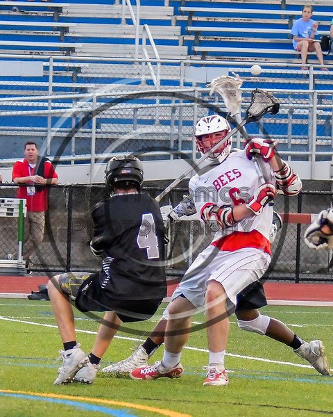 Baldwinsville Bees Charlie Bertrand (6) has the ball knocked off his stick by Syracuse Cougars defender Liam Clayton (4) in Section III Boys Lacrosse Semi-Finals action at the Bragman Stadium in Cicero, New York on Thursday, May 26, 2016.  Baldwinsville won 16-5.
