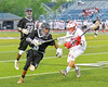 Syracuse Cougars goalie Yoendri Alonso (5) comes out of his net to carry the ball up field against Baldwinsville Bees Connor Smith (26) in Section III Boys Lacrosse Semi-Finals action at the Bragman Stadium in Cicero, New York on Thursday, May 26, 2016.  Baldwinsville won 16-5.