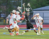 Baldwinsville Bees Nick Cacciola (4) defending agiant Syracuse Cougars John Elliott (22) in Section III Boys Lacrosse Semi-Finals action at the Bragman Stadium in Cicero, New York on Thursday, May 26, 2016.  Baldwinsville won 16-5.
