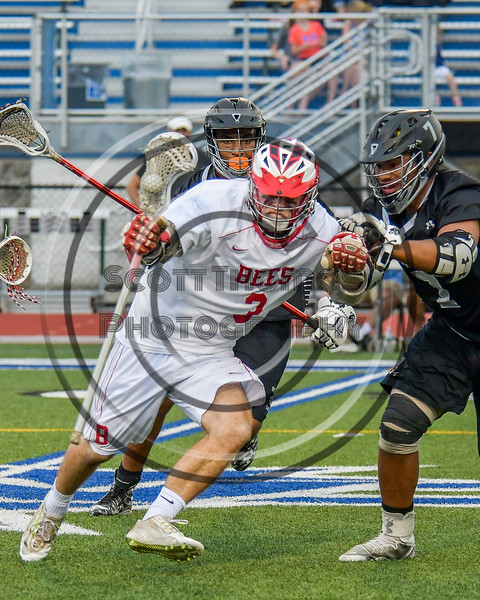 Baldwinsville Bees Ryan ingerson (3) protects the ball from Syracuse Cougars Jakev Jackson (7) in Section III Boys Lacrosse Semi-Finals action at the Bragman Stadium in Cicero, New York on Thursday, May 26, 2016.  Baldwinsville won 16-5.