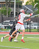 Baldwinsville Bees Matt Dickman (23) passing the ball over the Syracuse Cougars Liam Clayton (4) in Section III Boys Lacrosse Semi-Finals action at the Bragman Stadium in Cicero, New York on Thursday, May 26, 2016.  Baldwinsville won 16-5.