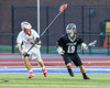 Baldwinsville Bees Ben Dwyer (5) defending against Syracuse Cougars Sterling Claflin (19) in Section III Boys Lacrosse Semi-Finals action at the Bragman Stadium in Cicero, New York on Thursday, May 26, 2016.  Baldwinsville won 16-5.