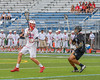 Baldwinsville Bees Matt Dickman (23) passing the ball against Syracuse Cougars Jahaad Henry (3) in Section III Boys Lacrosse Semi-Finals action at the Bragman Stadium in Cicero, New York on Thursday, May 26, 2016.  Baldwinsville won 16-5.