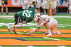 Baldwinsville Bees Evan Stolicker (32) facing off against Fayetteville-Manlius Hornets Tommy Ryu (22) in Section III Boys Lacrosse Championship action at the Carrier Dome in Syracuse, New York on Saturday, May 28, 2016.  Fayetteville-Manlius won 8-7.