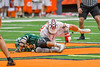 Baldwinsville Bees Evan Stolicker (32) battles for the ball at the face-off circle with Fayetteville-Manlius Hornets Tommy Ryu (22) in Section III Boys Lacrosse Championship action at the Carrier Dome in Syracuse, New York on Saturday, May 28, 2016.  Fayetteville-Manlius won 8-7.