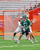 Fayetteville-Manlius Hornets Dan Burnam (23) backing down on a Baldwinsville Bees defender in Section III Boys Lacrosse Championship action at the Carrier Dome in Syracuse, New York on Saturday, May 28, 2016.  Fayetteville-Manlius won 8-7.