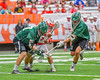 Baldwinsville Bees Ryan ingerson (3) and Fayetteville-Manlius Hornets Tommy Ryu (22) and Owen Penoyer (21) battle for a ground ball in Section III Boys Lacrosse Championship action at the Carrier Dome in Syracuse, New York on Saturday, May 28, 2016.  Fayetteville-Manlius won 8-7.