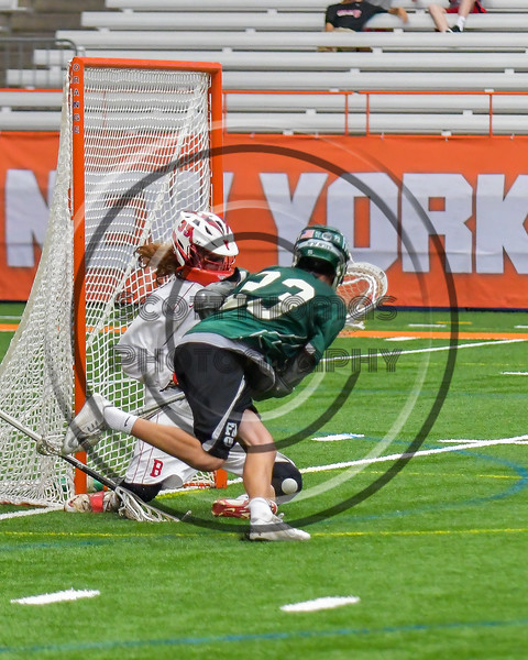 Baldwinsville Bees goalie Riley Smith (35) makes a save on Fayetteville-Manlius Hornets Dan Burnam (23) in Section III Boys Lacrosse Championship action at the Carrier Dome in Syracuse, New York on Saturday, May 28, 2016.  Fayetteville-Manlius won 8-7.