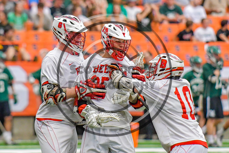 Baldwinsville Bees Brandon Kohutanich (25) is congratulated for his goal against the Fayetteville-Manlius Hornets by teammates Charlie Bertrand (6) and Dillon Darcangelo (10) in Section III Boys Lacrosse Championship action at the Carrier Dome in Syracuse, New York on Saturday, May 28, 2016.  Fayetteville-Manlius won 8-7.