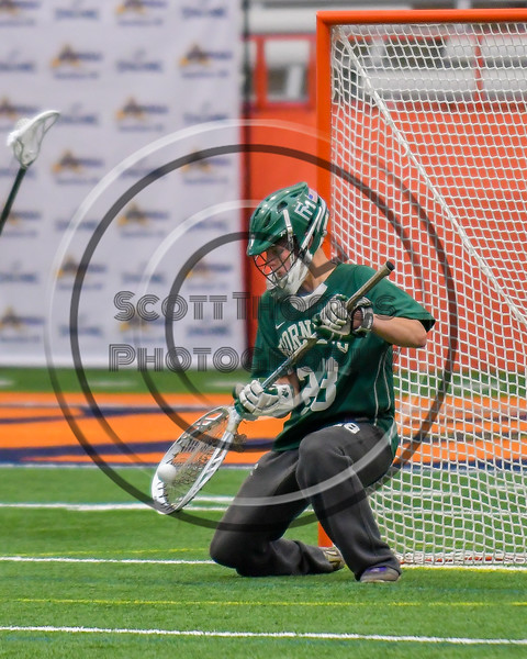 Fayetteville-Manlius Hornets goalie Ryan Boshart (28) makes a save against the Baldwinsville Bees in Section III Boys Lacrosse Championship action at the Carrier Dome in Syracuse, New York on Saturday, May 28, 2016.  Fayetteville-Manlius won 8-7.