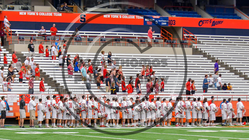 Baldwinsville Bees stand for the National Anthem before plyaing the Fayetteville-Manlius Hornets in the Section III Class A Boys Lacrosse Championship Game at the Carrier Dome in Syracuse, New York on Saturday, May 28, 2016.