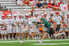 Baldwinsville Bees Patrick Delpha (11) running with the ball while being chased by a Fayetteville-Manlius Hornets player in Section III Boys Lacrosse Championship action at the Carrier Dome in Syracuse, New York on Saturday, May 28, 2016.  Fayetteville-Manlius won 8-7.