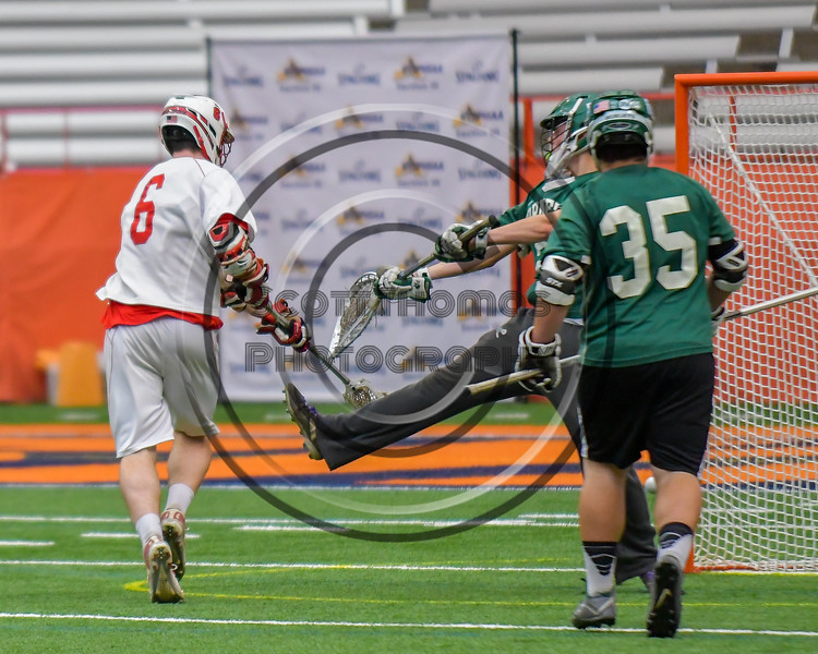 Baldwinsville Bees Charlie Bertrand (6) puts the ball past Fayetteville-Manlius Hornets goalie Ryan Boshart (28) for a goal in Section III Boys Lacrosse Championship action at the Carrier Dome in Syracuse, New York on Saturday, May 28, 2016.  Fayetteville-Manlius won 8-7.
