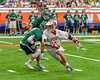 Baldwinsville Bees Dillon Darcangelo (10) cuts around Fayetteville-Manlius Hornets James Rettinger (7) in Section III Boys Lacrosse Championship action at the Carrier Dome in Syracuse, New York on Saturday, May 28, 2016.  Fayetteville-Manlius won 8-7.