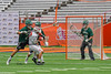 Baldwinsville Bees Cole Peters (37) gets checked in front of Fayetteville-Manlius Hornets goalie Ryan Boshart (28) in Section III Boys Lacrosse Championship action at the Carrier Dome in Syracuse, New York on Saturday, May 28, 2016.  Fayetteville-Manlius won 8-7.
