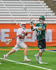 Fayetteville-Manlius Hornets Owen Penoyer (21) passing the ball against over Baldwinsville Bees Connor Smith (26) in Section III Boys Lacrosse Championship action at the Carrier Dome in Syracuse, New York on Saturday, May 28, 2016.  Fayetteville-Manlius won 8-7.