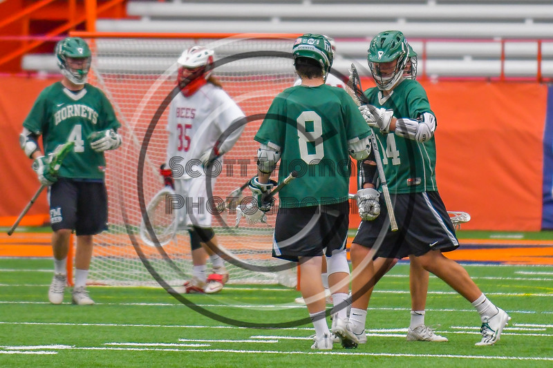 Fayetteville-Manlius Hornets David Steria (14) gets congratulations after scoring a goal agianst the Baldwinsville Bees in Section III Boys Lacrosse Championship action at the Carrier Dome in Syracuse, New York on Saturday, May 28, 2016.  Fayetteville-Manlius won 8-7.