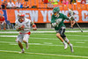 Fayetteville-Manlius Hornets James Rettinger (7) running with the ball as Baldwinsville Bees Ryan ingerson (3) gives chase in Section III Boys Lacrosse Championship action at the Carrier Dome in Syracuse, New York on Saturday, May 28, 2016.  Fayetteville-Manlius won 8-7.