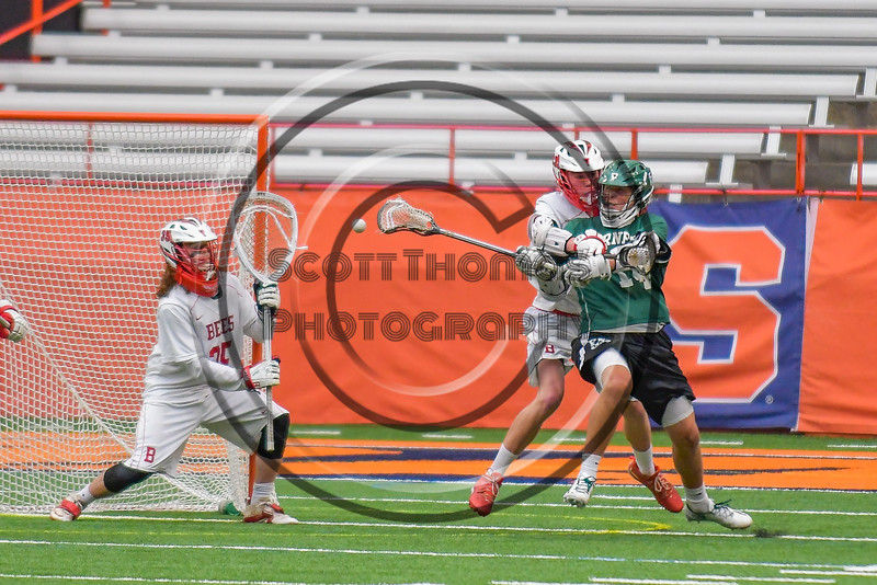 Fayetteville-Manlius Hornets Tyler Papa (14) shoots and scores agianst Baldwinsville Bees goalie Riley Smith (35) in Section III Boys Lacrosse Championship action at the Carrier Dome in Syracuse, New York on Saturday, May 28, 2016.  Fayetteville-Manlius won 8-7.