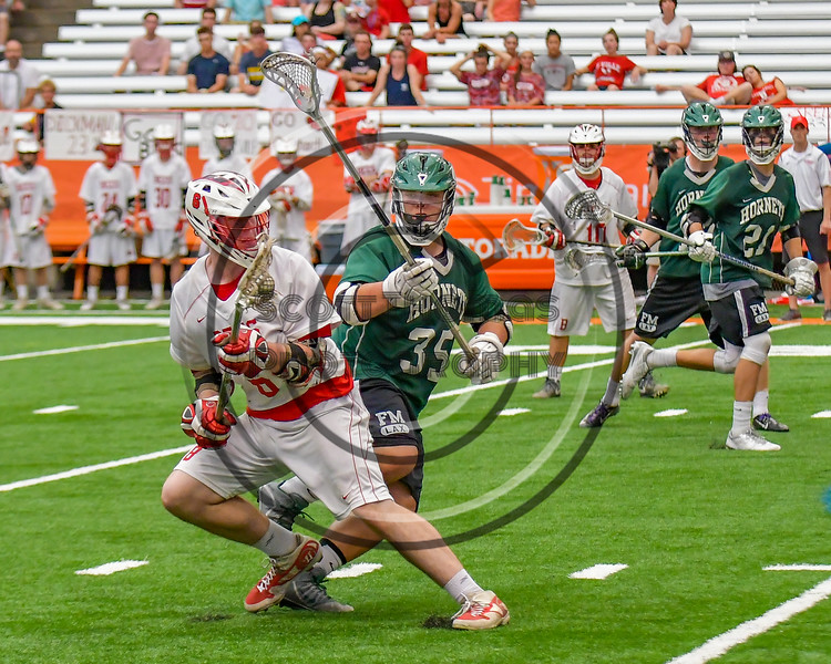 Baldwinsville Bees Charlie Bertrand (6) being defended by Fayetteville-Manlius Hornets Joe Avellino (35) in Section III Boys Lacrosse Championship action at the Carrier Dome in Syracuse, New York on Saturday, May 28, 2016.  Fayetteville-Manlius won 8-7.