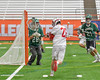Baldwinsville Bees Connor Smith (26) gets a shot off at Fayetteville-Manlius Hornets goalie Ryan Boshart (28) in Section III Boys Lacrosse Championship action at the Carrier Dome in Syracuse, New York on Saturday, May 28, 2016.  Fayetteville-Manlius won 8-7.