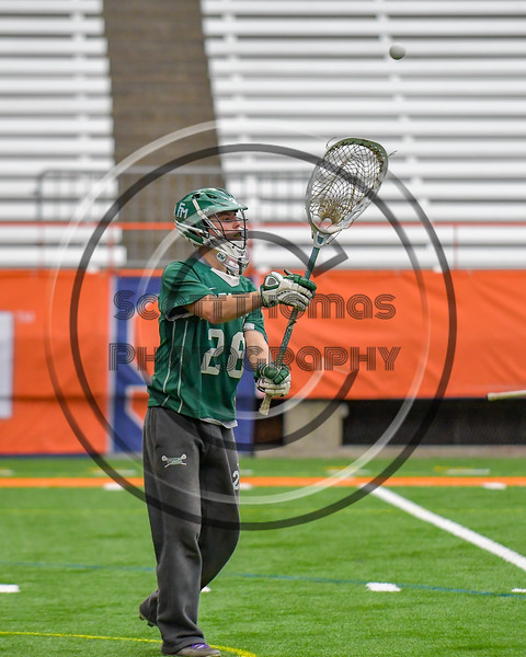 Fayetteville-Manlius Hornets goalie Ryan Boshart (28) passes the ball against the Baldwinsville Bees in Section III Boys Lacrosse Championship action at the Carrier Dome in Syracuse, New York on Saturday, May 28, 2016.  Fayetteville-Manlius won 8-7.