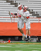 Baldwinsville Bees Peter Fiorni III (13)  is greeted by Brandon Kohutanich (25) as he is introduced before playing the Fayetteville-Manlius Hornets in the Section III Class A Boys Lacrosse Championship game at the Carrier Dome in Syracuse, New York on Saturday, May 28, 2016.
