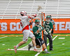 Baldwinsville Bees Charlie Bertrand (6) passes the ball over Fayetteville-Manlius Hornets Joe Avellino (35) and goalie Ryan Boshart (28) in Section III Boys Lacrosse Championship action at the Carrier Dome in Syracuse, New York on Saturday, May 28, 2016.  Fayetteville-Manlius won 8-7.