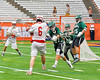 Baldwinsville Bees Charlie Bertrand (6) lining up a shot at the Fayetteville-Manlius Hornets net as defenders Owen Penoyer (21), Joe Avellino (35) and goalie Ryan Boshart (28) line up to stop him in Section III Boys Lacrosse Championship action at the Carrier Dome in Syracuse, New York on Saturday, May 28, 2016.  Fayetteville-Manlius won 8-7.