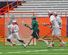 Baldwinsville Bees goalie Riley Smith (35) makes a save on Fayetteville-Manlius Hornets Luke Hamel (1) in Section III Boys Lacrosse Championship action at the Carrier Dome in Syracuse, New York on Saturday, May 28, 2016.  Fayetteville-Manlius won 8-7.