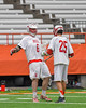 Baldwinsville Bees Charlie Bertrand (6) is greeted by Brandon Kohutanich (25) as he is introduced before playing the Fayetteville-Manlius Hornets in the Section III Class A Boys Lacrosse Championship game at the Carrier Dome in Syracuse, New York on Saturday, May 28, 2016.