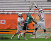 Baldwinsville Bees goalie Riley Smith (35) makes a save on Fayetteville-Manlius Hornets Dan Burnam (23) with John Petrelli (33) defending in Section III Boys Lacrosse Championship action at the Carrier Dome in Syracuse, New York on Saturday, May 28, 2016.  Fayetteville-Manlius won 8-7.