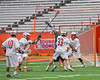 Baldwinsville Bees defenders John Petrelli (33) and Ben Dwyer (5) check the ball away from Fayetteville-Manlius Hornets Dan Burnam (23) in Section III Boys Lacrosse Championship action at the Carrier Dome in Syracuse, New York on Saturday, May 28, 2016.  Fayetteville-Manlius won 8-7.