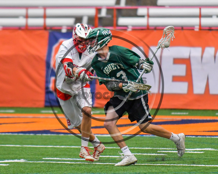 Baldwinsville Bees Kyle Pelcher (29) defending against Fayetteville-Manlius Hornets Dan Burnam (23) in Section III Boys Lacrosse Championship action at the Carrier Dome in Syracuse, New York on Saturday, May 28, 2016.  Fayetteville-Manlius won 8-7.