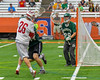 Baldwinsville Bees Connor Smith (26) scoring attempt is stopped by the Fayetteville-Manlius Hornets defense in Section III Boys Lacrosse Championship action at the Carrier Dome in Syracuse, New York on Saturday, May 28, 2016.  Fayetteville-Manlius won 8-7.