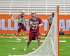Auburn Maroons goalie Nikoli Biljanowski (27) passing the ball against the Jamesville-Dewitt Red Rams in Section III Boys Class B Lacrosse Championship action at the Carrier Dome in Syracuse, New York on Saturday, May 28, 2016.  Jamesville-Dewitt won 15-7.
