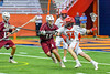 Jamesville-Dewitt Red Rams Grayson Burns (14) being defended by Auburn Maroons Tyler Spearing (15) in Section III Boys Class B Lacrosse Championship action at the Carrier Dome in Syracuse, New York on Saturday, May 28, 2016.  Jamesville-Dewitt won 15-7.