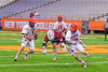 Auburn Maroons player battles for a ground ball against Jamesville-Dewitt Red Rams Anthony Digiovanni (37), Sam Mueller (1) and Jack Mulvihill (29) in Section III Boys Class B Lacrosse Championship action at the Carrier Dome in Syracuse, New York on Saturday, May 28, 2016.  Jamesville-Dewitt won 15-7.