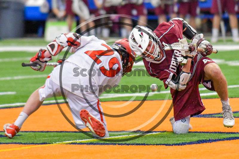 Auburn Maroons and Jamesville-Dewitt Red Rams face-off in Section III Boys Class B Lacrosse Championship action at the Carrier Dome in Syracuse, New York on Saturday, May 28, 2016.  Jamesville-Dewitt won 15-7.