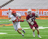 Auburn Maroons Jacob Morin (11) being defended by Jamesville-Dewitt Red Rams Andrew Barclay (15) in Section III Boys Class B Lacrosse Championship action at the Carrier Dome in Syracuse, New York on Saturday, May 28, 2016.  Jamesville-Dewitt won 15-7.