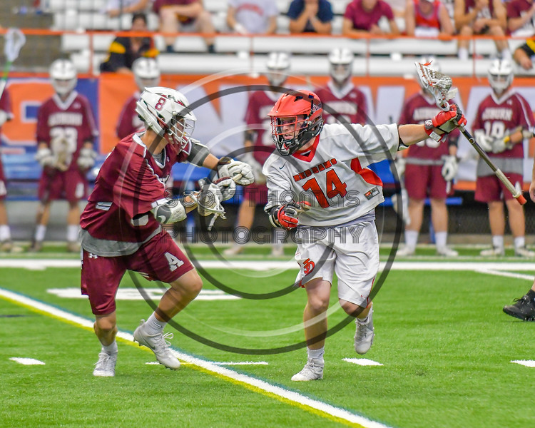 Auburn Maroons Mitch Fanning (8) defending against Jamesville-Dewitt Red Rams Grayson Burns (14) in Section III Boys Class B Lacrosse Championship action at the Carrier Dome in Syracuse, New York on Saturday, May 28, 2016.  Jamesville-Dewitt won 15-7.