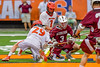 Auburn Maroons Kevin Munn (3) facing off against Jamesville-Dewitt Red Rams Jack Mulvihill (29) in Section III Boys Class B Lacrosse Championship action at the Carrier Dome in Syracuse, New York on Saturday, May 28, 2016.  Jamesville-Dewitt won 15-7.