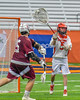 Jamesville-Dewitt Red Rams goalie Patrick Gillson (5) passing the ball against the Auburn Maroons in Section III Boys Class B Lacrosse Championship action at the Carrier Dome in Syracuse, New York on Saturday, May 28, 2016.  Jamesville-Dewitt won 15-7.