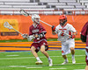 Auburn Maroons Kaiden Tubbert (5) being defended by Jamesville-Dewitt Red Rams Rosario Digristina (2) in Section III Boys Class B Lacrosse Championship action at the Carrier Dome in Syracuse, New York on Saturday, May 28, 2016.  Jamesville-Dewitt won 15-7.