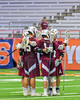 Auburn Maroons celebrate a goal against the Jamesville-Dewitt Red Rams in Section III Boys Class B Lacrosse Championship action at the Carrier Dome in Syracuse, New York on Saturday, May 28, 2016.  Jamesville-Dewitt won 15-7.