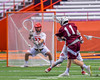 Auburn Maroons Jacob Morin (11) shoots and scores against the Jamesville-Dewitt Red Rams in Section III Boys Class B Lacrosse Championship action at the Carrier Dome in Syracuse, New York on Saturday, May 28, 2016.  Jamesville-Dewitt won 15-7.