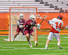 Auburn Maroons Tyler Spearing (15) defending a shot from Jamesville-Dewitt Red Rams Grayson Burns (14) in Section III Boys Class B Lacrosse Championship action at the Carrier Dome in Syracuse, New York on Saturday, May 28, 2016.  Jamesville-Dewitt won 15-7.