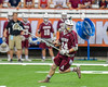 Auburn Maroons Sam Ferro (24) looking to make a play against the Jamesville-Dewitt Red Rams in Section III Boys Class B Lacrosse Championship action at the Carrier Dome in Syracuse, New York on Saturday, May 28, 2016.  Jamesville-Dewitt won 15-7.